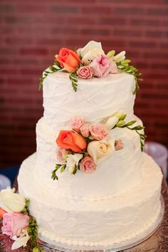 White wedding cake with messy icing.