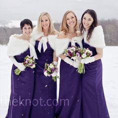 The bridesmaids wore floor-length plum dresses and kept warm in white, faux-fur boleros.