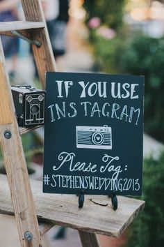 Make a sign with your wedding's hashtag so that wedding guests can tag their photos taken at your wedding.