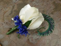 This is a listing for 1 lime rose boutonniere with purple flower and peacock sward feather accent.  If you need ribbon wrapped on the flower stem