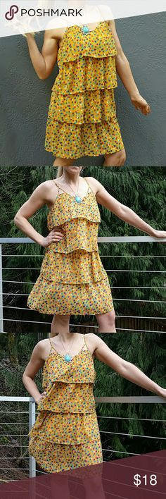 """SALEPlayfully flirty Sunshine dress  Host pick  Brand new no tag  Add alittle sunshine to your day with this Fun & Playful dress yellow dress!! 4 tiers of playful ruffles layer this fabulously fun dress. Pair with a denim jacket & your favorite booties and you are ready to have an amazing day!  Size Small (no tag) Spaghetti straps (adjustable) Yellow with multiple colored polka-dots Bust 32"""" around Length approx:33"""" but will vary depending on where you adjust strapes  Cruise, Vacation…"""
