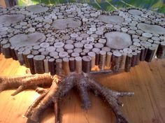 Coffee table. The table top is made from a couple hundred 2 inch pieces of wood…
