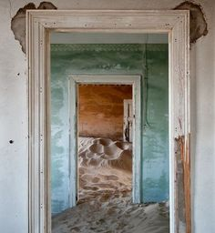 """Photographer, Álvaro Sánchez-Montañés traveled to Kolmanskop, a ghost town in southern Namibia that had once been a rich mining village. He shot these surreal images of deserted buildings filled with sand blown in by the wind, capturing """"beauty in the abandoned, of the useless, of time passing by."""""""