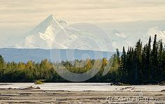 Photo about The Delta River curves around beneath the peaks of the Alaska Mountain Range. Image of mountainous, landscape, lagoon - 61712267 Delta River, Mountain Range, Video Footage, Ecology, Alaska, Perspective, Curves, Sky, Stock Photos