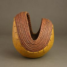 Hannie Goldgewicht   Hand thrown ceramic bases with pin needle and wax thread basketry