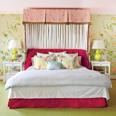 Pretty Floral Bedroom - Restful Master Bedrooms - Southernliving. The hand-painted floral wallcovering was the starting point behind every other color choice in this bedroom: the apple green rug, the pair of chartreuse gourd lamps, the hot pink velvet upholstered bed, and patterned linens from the homeowner's store, Biscuit Home.  See more of this Colorful Home Remodel