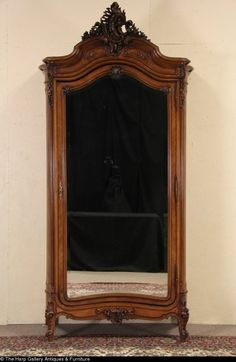 French 1900 Carved Antique Armoire, Beveled Mirror Door.