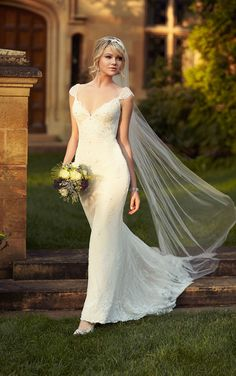 This stunning Lace over Lustre Satin sheath bridal gown features fashionable cap sleeves, a stunning V-neckline, and sparkling Diamante accents throughout. You'll love how the Lustre Satin hugs your every curve, while the Lace delicately flows past the under-dress into an elegant train. You can customize this designer Essense of Australia sheath dress to best …