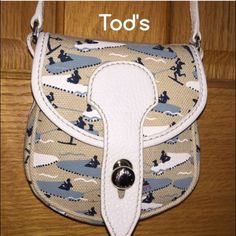 "Tod'sAuthentic NWT/Rare Bag Tod's Bag, Mini Bag, Shoulder Bag, Crossbody Bag, designed by fashion illustrator Michael Roberts of The New Yorker, for Tod's in 2005. Crafted by Italian artisans of Tod's nautical print, treated cotton canvas, white Italian leather strap & silver hardware. Strap drop-21-25"" Just right for a summer event!  All studs are marked & has the inside authentication tag. A rare find, unused & mint, MSRP $445. No odors/smoke, pet friendly home. trades, offers accepted…"