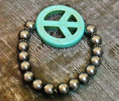 Beautiful chunky smokey black beads with large peace sign bead bracelet by AhrensGallery on Etsy