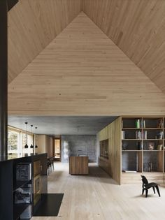rural cabin with blonde wood and concrete interior - voralberg austria - bernardo bader architects - photo by adolf bereuter
