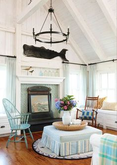 New England style beach cottage living room... Whale wall decor is often seen in those cottages, in reference to the whaling tradition of the past. #cottage