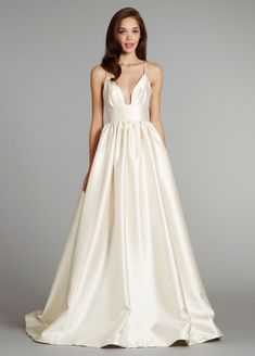 Blush - Style 1255 Ivory Mikado bridal ball gown with accentuated cinched waist, beaded crossover straps and chapel train