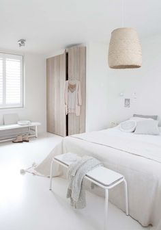 White bedroom with subtle contrasts