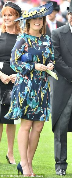 Making a statement: Eugenie brought a splash of colour to the event in blue and yellow...