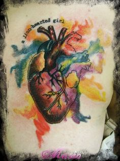 "rainbow anatomical heart tattoo - with colors like this but NOT AT ALL this style. not so watercolor. with ""cause I'm tired of not being able to bleed."" on right shoulder."