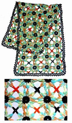 Chal tejido a crochet en acrílico Faisán Pimpinella de Lanabel, matizado en anaranjado, turquesa verdes y amarillos, con acrílico negro y anaranjado, talla única