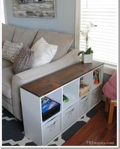Use a bookcase for surface and storage space in a small living room. From pbjinteriors.com #smalllivingroom #livingroom #smallspace #bookcase