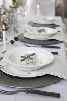 In love with the aged zinc charges and the clean crisp white tableware