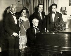Birthday party honoring Maurice Ravel in New York City, March 8, 1928. From left: Oscar Fried; Eva Gauthier; Ravel at piano; Manoah Leide-Tedesco; and George Gershwin.