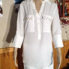 "Sofia Vergara Lovely Blouse Ivory with gold studs. 100% polyester. Bust is 40"". Length is 27"". The sleeves can be worn down or buttoned. Sleeve length  buttoned is 10"". Unbuttoned it is 12"". No holes, rips, stains. Or tears. Beautiful condition. Non smoking home Sofia Vergara Tops Blouses"