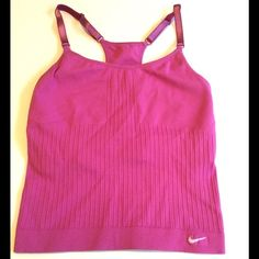 Pink Nike Sports Bra, Size XS/S Pink /fuschia xs/s sports bra from Nike.  Best fits XS in my opinion.  The color is slightly lighter than depicted in photos.  Adjustable straps, cute racer back design.  Great color and style.  Excellent condition, only worn 1-2 times.  Price is firm due to flat PM fee.  However willing to create new bundle at discount. Nike Tops