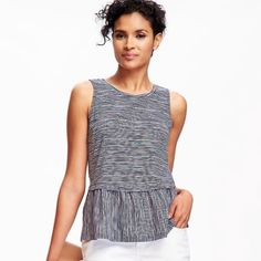 NWT's relaxed peplum top. NWT's relaxed peplum top. Navy color. 100% cotton. Machine wash with crew neck;sleeveless. Soft, medium- weight jersey. Relaxed fit Tee hits below the waist Tops