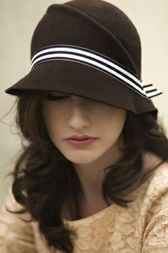 Sculpted brown hat with white ribbon