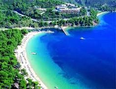 Skiathos. I think Kukunaries is one of the best places to swim. I won't forget all that green so close to the sea!