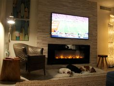 Simple fireplace design with stone surround
