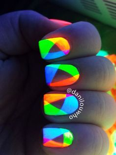 Give a certain edge to your nails by painting overlapping abstract shapes in glow in the dark nail polish. The rainbow colors are a great contrast to each other giving a new color each time one layer overlaps with another.