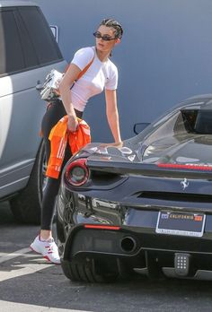 Keeping up: Jenner sported Kardashian-esque braids and tiny sunglasses and carried her belongings in a silver Heron Preston backpack Kendall Jenner Instagram, Kendall Jenner Car, Kendall Jenner Outfits, Kardashian Jenner, Kylie Jenner Ferrari, Kendall Jenner Workout, Bruce Jenner, Sugar Baby, Le Style Du Jenner