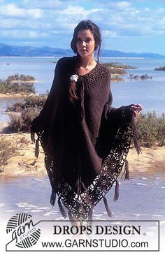DROPS Poncho in Ull-Bouclé with crocheted flower squares and fringes  Pattern…