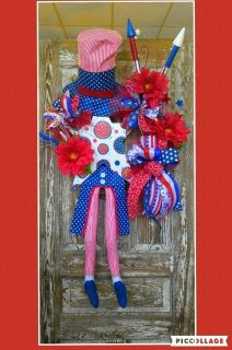 This beautiful grapevine wreath on your door will catch anyone's eye this July 4th!  Can also be used year round during other holidays: Memorial Day, Labor Day, and Veteran's Day! Dimensions: 46 in. Length 23 in. Width