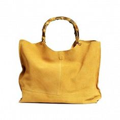 H&M suede bag with a bamboo-effect handle.