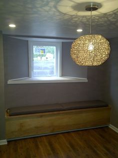 bench seat with added storage under an egress window... nice idea for the basement family room...different wall color of course...