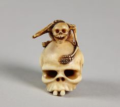 Netsuke of Skeleton Astride a Skull, 19th century. Japanese.
