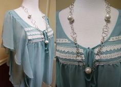Love the soft flowing lines and lace accents of this top. The material drapes any figure elegantly!
