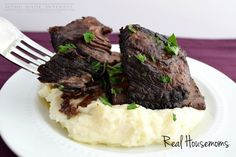 Braised short ribs slow-cooked in red wine with carrots, celery and ...