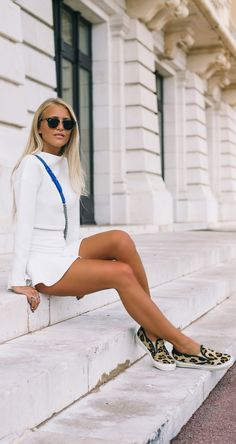 Janni Deler is wearing a white top from Bubbleroom, white skirt from Choies, bag from Chanel and slip-on shoes are from Daniel Footwear