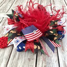 A cute patriotic camouflage big hair bow in honor of family members serving in the military. Thick, American Flag printed ribbons gather with loops of subtle camouflage, fe. Big Hair Bows, Toddler Hair Bows, Making Hair Bows, Big Bows, Holiday Hair Bows, Special Occasion Hairstyles, Vintage Headbands, Shabby Flowers, Boutique Hair Bows