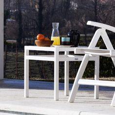 An aluminum side table finished in white is a sleek addition to an outdoor area.   $328