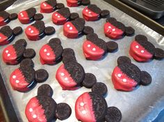 Mickey Mouse cookie heads.  I used 1 large Oreo and 1 mini Oreo split in half for the years.  All held together and decorated with melting chocolate.