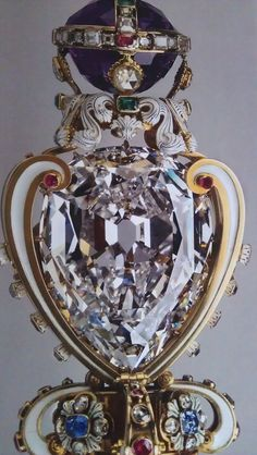 The Sovereign's Sceptre with Cross that is set with the largest of the Cullinan diamonds known as the Star of Africa or Cullinan I that weighs 530.2 carats. The Sceptre is part of the Crown Jewels.  britain tiara  came from south africa