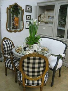 .Black and white checks on curvy French chairs