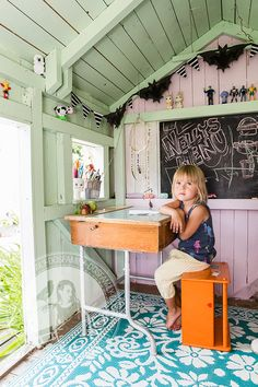 Frank´s playhouse By DosFamily | Dos Familyplayhouse by dosfamily in ystad sweden. Pink and green play house with a check out desk and school bench. Chalk board paint and bats on a string. Fleamarket finds. ghostbusters. big boy. brio stove and sink. / Lekstuga