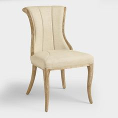 Boasting a shapely silhouette with deep vertical channels in the backrest, our exclusive natural khaki dining chairs are a sophisticated update to a more traditional design. These modern classics are crafted of oak with distressed legs and smooth linen-blend upholstery.