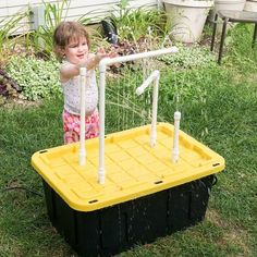 Put together this fun DIY water table, complete with fountains and sprayers, in less than an hour!
