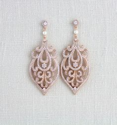 These beautifully detailed earrings I have exclusively created for Treasures by Agnes and it is only available here. Gorgeous Art Deco inspired design completely studded with tons of sparkly cubic zirconia stones. Accented with Swarovski pearls. Available in Rose gold or Rhodium plated