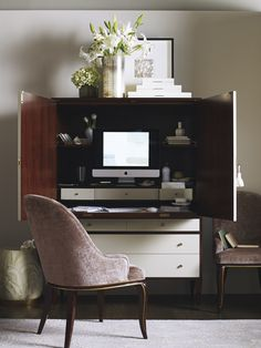 The Social Study by Barbara Barry can serve as a computer desk, a wardrobe or a wet bar. (Baker Furniture)
